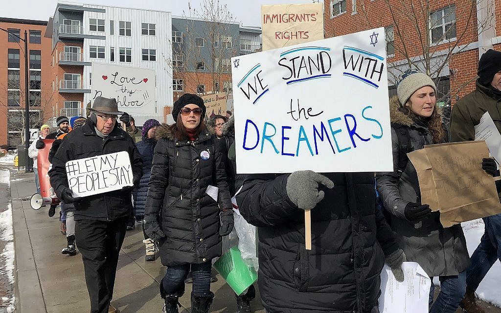 Protesters march with signs in support of Dreamers and a clean Dream Act at a Pittsburgh march in January. (Photo by Lauren Rosenblatt)