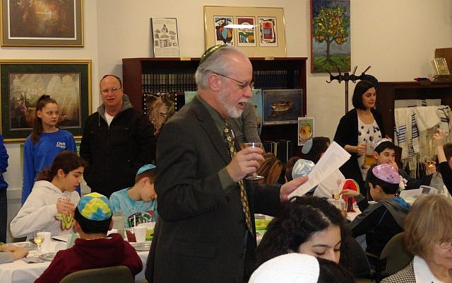 Tree Of Life*Or L'Simcha Congregation Rabbi Chazzan Jeffrey Myers officiates a Tu B'Shevat seder. The congregation shares a building with For Hadahs and New Light Congregation. (Photo by Barry Werber)