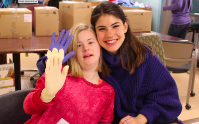 Emily Ford, left, and Riki Rudolph of the Friendship Circle participate in a volunteer event. Friendship Circle specializes in providing engagement opportunities for children and young adults with special needs. (Photo courtesy of Jewish Federation of Greater Pittsburgh)