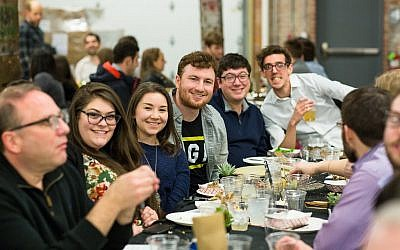 Seventy-five people participated in the OneTable launch. These diners had a lot to smile about. (Photo by Lovas Photography and Design)