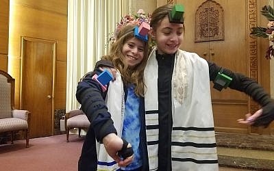 Haley Levine and Gabi Zimmerman, fifth-graders at Torah Lishmah Community, the religious school of Tree of Life*Or L'Simcha Congregation, participated in the World Wide Wrap and modeled their tefillin.  (Photo courtesy of Torah Lishmah Community)