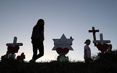 A makeshift memorial erected in front of Marjory Stoneman Douglas High School in Parkland, Fla., days after the shooting that left 17 students and teachers dead, Feb. 18, 2018. (Photo by Joe Raedle/Getty Images)