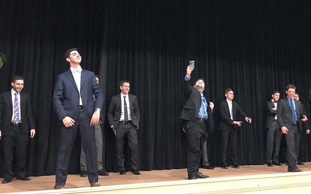 Contestants in the Mr. Nice Jewish Boy competition perform a group dance. (Photo by Lauren Rosenblatt)