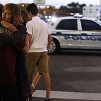 Kristi Gilroy hugs a young woman at a police checkpoint near the Marjory Stoneman Douglas High School. (Photo by Mark Wilson / Getty Images)