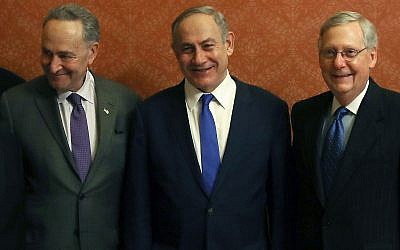 Israeli Prime Minister Benjamin Netanyahu, center, with Democratic Sen. Chuck Schumer, left, and Republican Sen. Mitch McConnell after addressing Congress in 2015. (Photo by Mark Wilson/Getty Images)