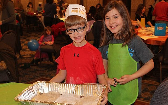 Judah Paris and Mira Schwartz at the Kids' Mega Matzah Event. (Photo courtesy of Chabad of Squirrel Hillel)