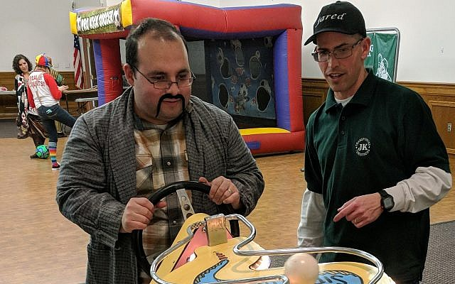 Community members enjoy a game at Temple Sinai's Adult Purim Carnival on Saturday, Feb. 24. (Photo courtesy of Temple Sinai)