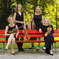 From left: Jennifer Orchard, violin; Tatjana Mead Chamis, viola; Bronwyn Banerdt, cello; and Marta Krechkovsky, violin. (Photo by Todd Rosenburg)