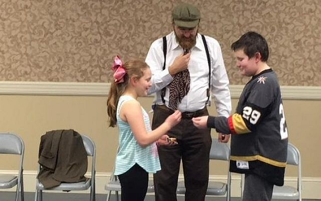 "Amichai Pardo as Januz Korczak, Callie Sloan and Jacob Carney decide what to do with the ""treasure"" hidden in the matchbox. (Photo courtesy of Temple David)"