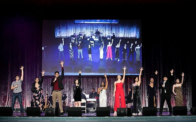 The 10 finalists conclude their group medley produced by Jill Machen. (Photo by Christina Montemurro Photography)