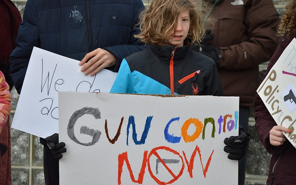 A student at Community Day School participates in the national walkout for gun reform in March. (Photo courtesy of Community Day School)