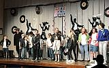 "Students from Temple Emanuel and Beth El Congregaton perform a parody of ""Grease"" for Purim. (Photo by Rob Goodman)"