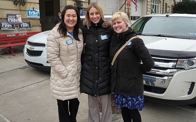 Erika Strassburger (center) joined by campaign supporters Itha Cao (left) and Alicia Carberry (right) outside of the Northumberland Street polling station on election day. (Photo by Adam Reinherz)