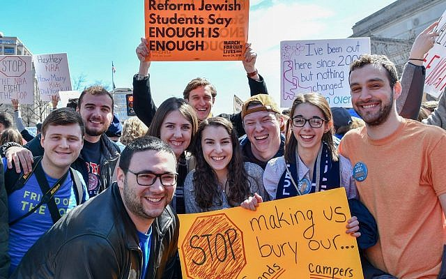 Reform Jewish college students from around the country (Pitt, BU, OSU, UCSB, JMU), standing at the corner of Pennsylvania and 9th as the March For Our Lives began. (Photo from NFTY Official Facebook Page)