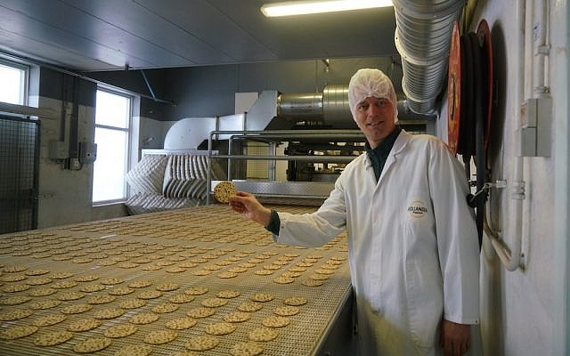 Pieter Heijs shows his product at his Hollandia Matzes factory in Enschede, the Netherlands, March 19, 2018. (Photo by Cnaan Liphshiz)