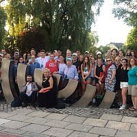 Educators, students and lay leaders on a 2017 trip to Poland with Classrooms Without Borders, one of many trips that organizations lead to Poland from Pittsburgh. The group poses for a photo in the town of Kielce, Poland. (Photo by Jahee Cho)