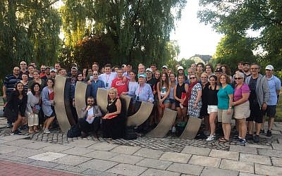 Educators, students and lay leaders joined Classrooms Without Borders on a 2017 trip to Poland. The group poses for a photo in the town of Kielce, Poland. (Photo by Jahee Cho)