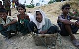 Rohingya Muslims, who crossed over from Myanmar into Bangladesh, sit beside a road in Ukniya, Bangladesh. (Photo by Suvra Kanti Das/iStockphoto)