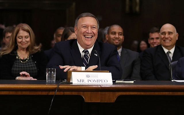 Mike Pompeo smiles at a moment of levity at a confirmation hearing before the Senate Intelligence Committee. (Photo by Joe Raedle/Getty Images)