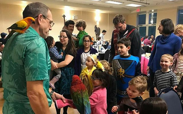 "Kenny Sprouse, better known as ""That Guy With The Birds,"" delights the children with his exotic birds. (Photo courtesy of Chabad of the South Hills)"