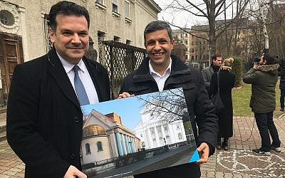 Raed Saleh, left, a Berlin senator, and the Berlin Jewish Community's president, Gideon Joffe, hold an architect's rendering of a planned reconstruction of the Fraenkelufer Synagogue. (Photo by Toby Axelrod)