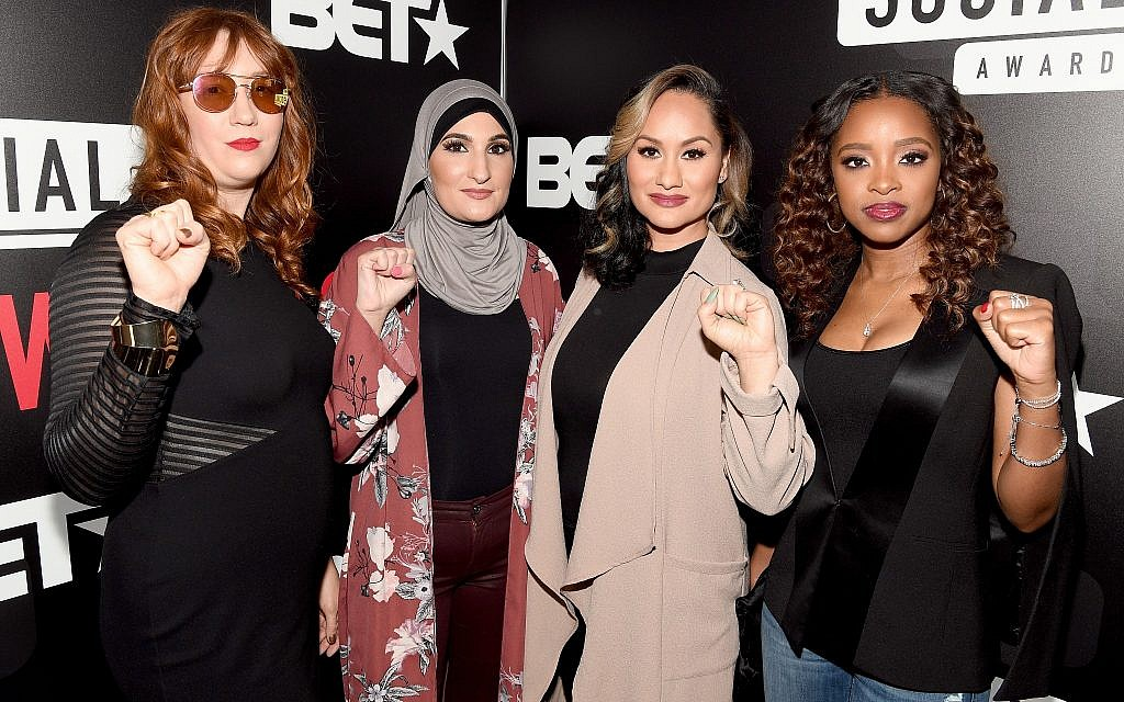 The organizers of the Women's March pose for a photo in Atlanta at BET's Social Awards: Bob Bland, Linda Sarsour, Carmen Perez and Tamika Mallory. Guest columnist Saul Golubcow argues that the movement is now associated with people who promote anti-Semitic rhetoric. (Photo by Paras Griffin / Getty Images for BET)