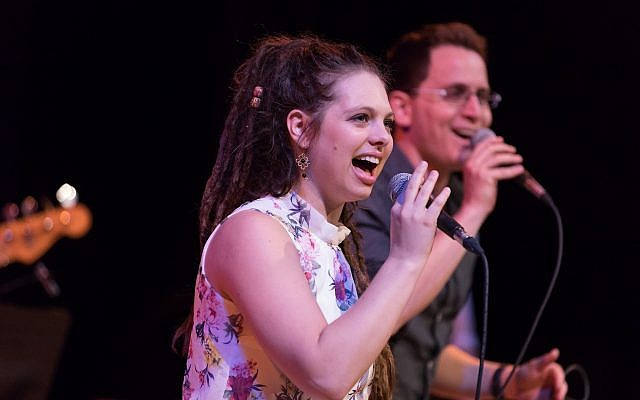 Lead singers of ISRABAND, an Israeli cover band, siblings Omri and Sheli Glickman, provided a high-energy set of authentic Israeli hits at the community celebration. (Photo by Josh Franzos)
