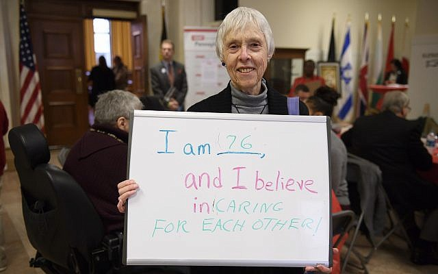 Karen Miyares, a Lawrenceville resident, celebrates her age and ideas at the first Age-Friendly Greater Pittsburgh Legislative Briefing on March 1 at the City Council Chamber. (Photo by Jeff Swensen / AARP Pennsylvania)