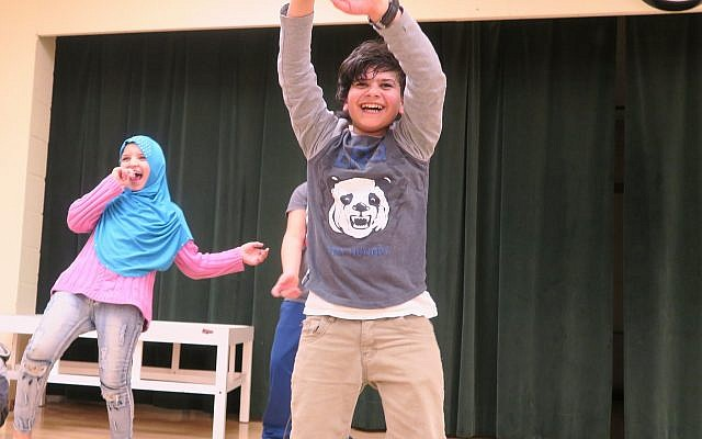Ahmad and Rawaa are cousins from Syria dancing and having a blast at the kickoff event at Jewish Family and Community Services on Feb. 13th. (Photo courtesy of JFCS)