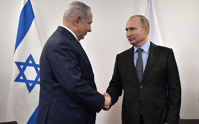 Israeli Prime Minister Benjamin Netanyahu, left, greets Russian President Vladimir Putin at the Jewish Museum and Tolerance Center in Moscow, Jan. 29, 2018. (Photo by Alexey Nikolsky/AFP/Getty Images)