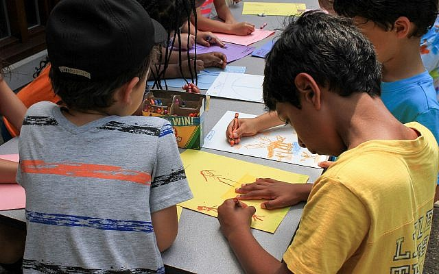 Students at Chatham Day Camp immerse themselves in an art project. (Photo by Olivia Ciotoli)