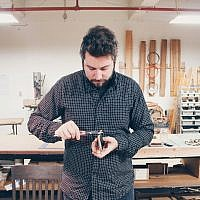 Ben Saks of KerfCase focuses on the task at hand. (Photo courtesy of KerfCase)