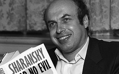 "Natan Sharansky pictured with a copy of his book ""Fear No Evil,"" July 1988. (Photo by Express Newspapers/Getty Images)"