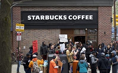 Protestors demonstrating outside a Starbucks in Philadelphia, April 15, 2018. (Photo by Mark Makela/Getty Images)
