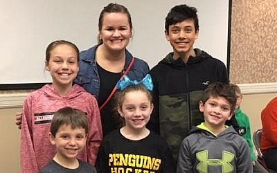 Kate Livingston (center), representing Beverly's Birthdays, was part of Temple David's Celebration of Learning. Natalie Keough, Josh and Nate Goldberg and Aidan and Sara Pechersky presented the organization with a check consisting of funds they raised throughout the year. (Photo courtesy of Temple David)