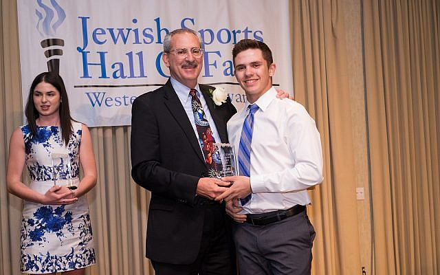 Hall of Fame President Arnie Reichbaum presents the Sidney Simon Memorial Scholarships to Jacob Weinberg, baseball, Pine Richland High School; and Carla Goldsmith, tennis, Peters Township High School. (Photo by Eric Reichbaum)