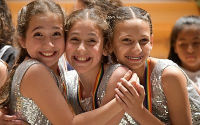 Ilyssa Bails, Abigail Naveh, Nofar Amram pose at the May 16 performance and competition that capped off the Dancing Classrooms program. (Photo courtesy of Community Day School)