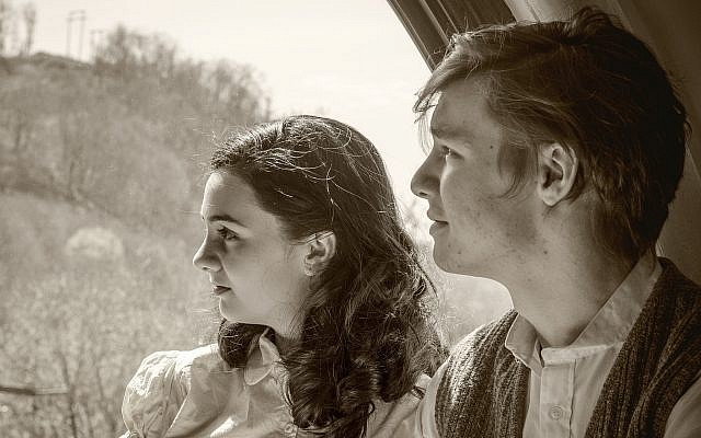 In the show, which runs through May 13 at the New Hazlett Theater, Anne Frank is played by Madeline Dalesio. Actor Somerset Young plays Peter van Daan. (Photo by Laura Slovesko)