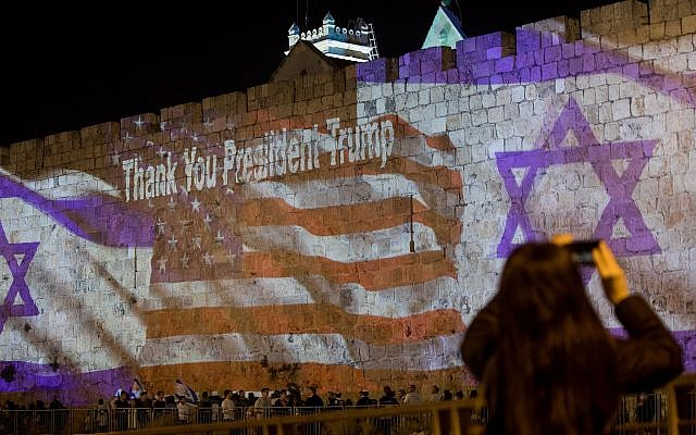The Israeli and the American flags are screened on the walls of Jerusalem's Old City on May 13, 2018, ahead of the opening of the U.S. embassy in Jerusalem. (Photo by Yontan Sindel/Flash90)