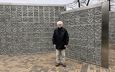 Albert Farhy, a Holocaust survivor who now lives in Pittsburgh, stands by the Gary and Nancy Tuckfelt Keeping Tabs sculpture at Community Day School. Farhy participated in the 2nd annual Walk to Remember on Sunday, April 29. (Photo by Lauren Rosenblatt)