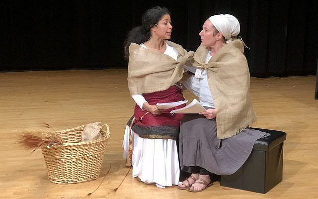 Naomi (Cara Shuckett) and Ruth (Delilah Picart) after Ruth returns from Boaz's field with barley for them to eat. (Photo by Sara Stock Mayo)