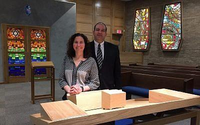 Rabbi Amy Greenbaum and her husband, Rabbi Alex Greenbaum, pose for a photo in the newly renovated chapel in Beth El Congregation of the South Hills. (Photo by Toby Tabachnick)
