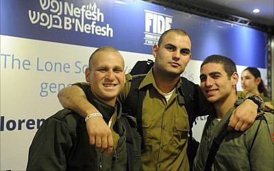 The errands day for lone soldiers is organized by Nefesh B'Nefesh and Friends of the Israel Defense Forces so that Israeli soldiers from abroad can take care of many bureaucratic chores in a single day. (Photo by Larry Luxner)