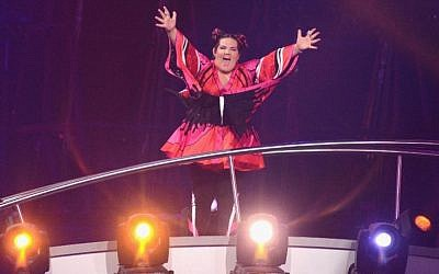 "Singer Netta Barzilai waves to the audience at Altice Arena in Lisbon after Israel's song ""Toy"" is announced winner of the 2018 Eurovision Song Contest. (Photo by Pedro Gomes/Getty Images)"