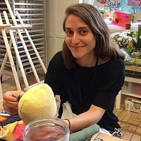 Merav Kamel works on a cloth doll. Kamel was F.I.N.E. Art Scholar at the Children's Museum of Pittsburgh. (Photo by Toby Tabachnick)