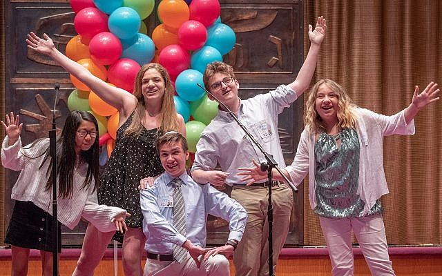 Temple Sinai teens performed a musical medley of popular songs rewritten to honor Rabbi Jamie Gibson. From left: Dora Gordon, Rebecca Gordon, Russell Petro, Ethan Beck and Rachel Petro. (Photo courtesy of Temple Sinai)