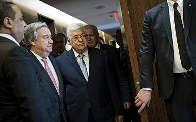Palestinian Authority President Mahmoud Abbas, center, next to Secretary-General of the United Nations Antonio Guterres, second from left, arrives at a meeting at U.N. headquarters in New York. (Photo by Drew Angerer/Getty Images)