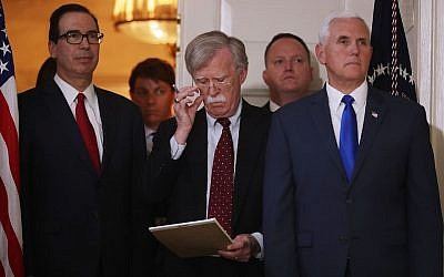 White House National Security Advisor John Bolton, center, flanked by Treasury Secretary Steven Mnuchin, left, and Vice President Mike Pence, listening to President Donald Trump announcing his decision to withdraw the U.S. Iran nuclear deal in the Diplomatic Room at the White House, May 8, 2018. (Photo by Chip Somodevilla/Getty Images)