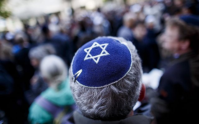 A man wears a kippah at a gathering in Berlin to protest anti-Semitism. (Photo by Carsten Koall/Getty Images)