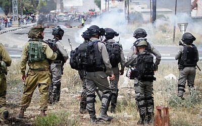 Israeli security forces on patrol during demonstrations near the Hawara checkpoint, south of the West Bank city of Nablus. (Photo by Nasser Ishtayeh/Flash90)